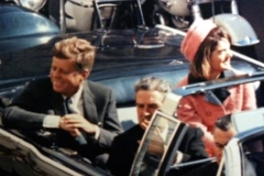 Minutes before the assassination: John F. Kennedy, his wife Jacqueline and the Governor of Texas in the convertible presidential limousine.